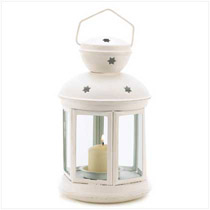 A traditional candle lantern gets a fresh contemporary look with matte white finish and charming star cutouts! A simple yet elegant complement sheds festive light on any setting.