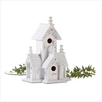 Victorian-style birdhouse features four roomy perches. Distressed white-finished wood with gingerbread trim has an heirloom look.